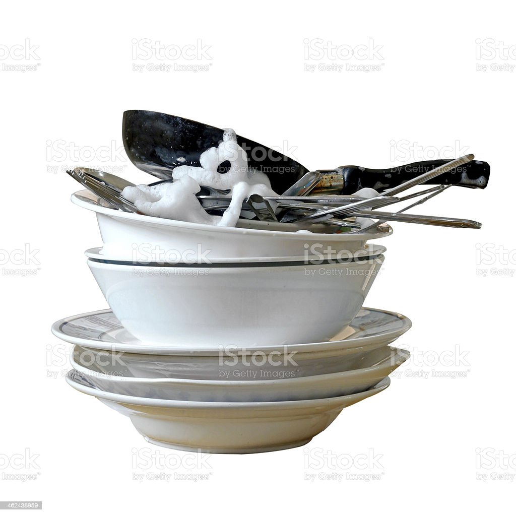 stack of dirty dishes and silverware with bubbles stock photo