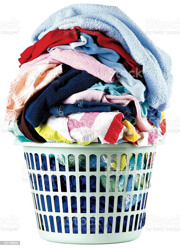 A stack of dirty laundry in a basket stock photo