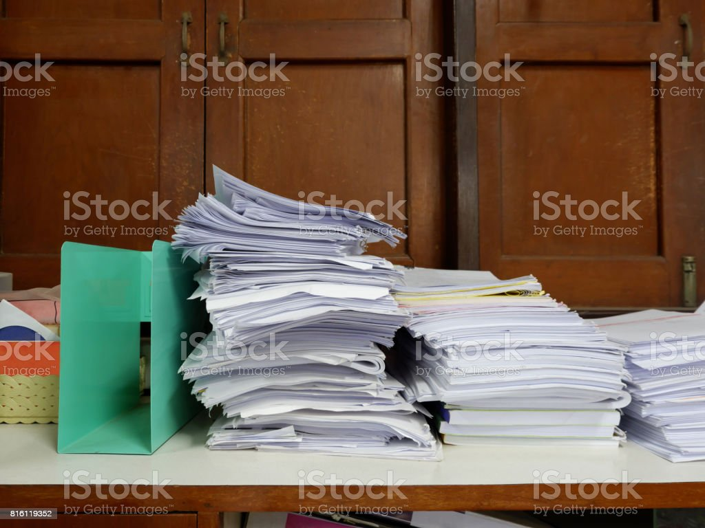 Stack of Documents at window in old office stock photo