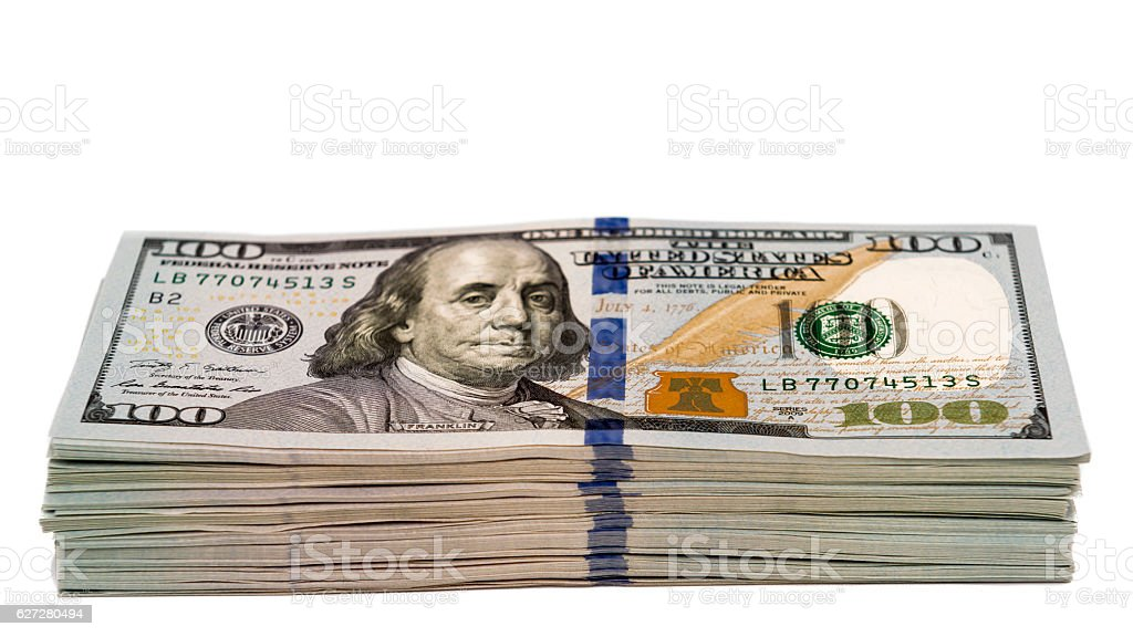 Stack of dollar banknotes isolated with focus on the 100 stock photo