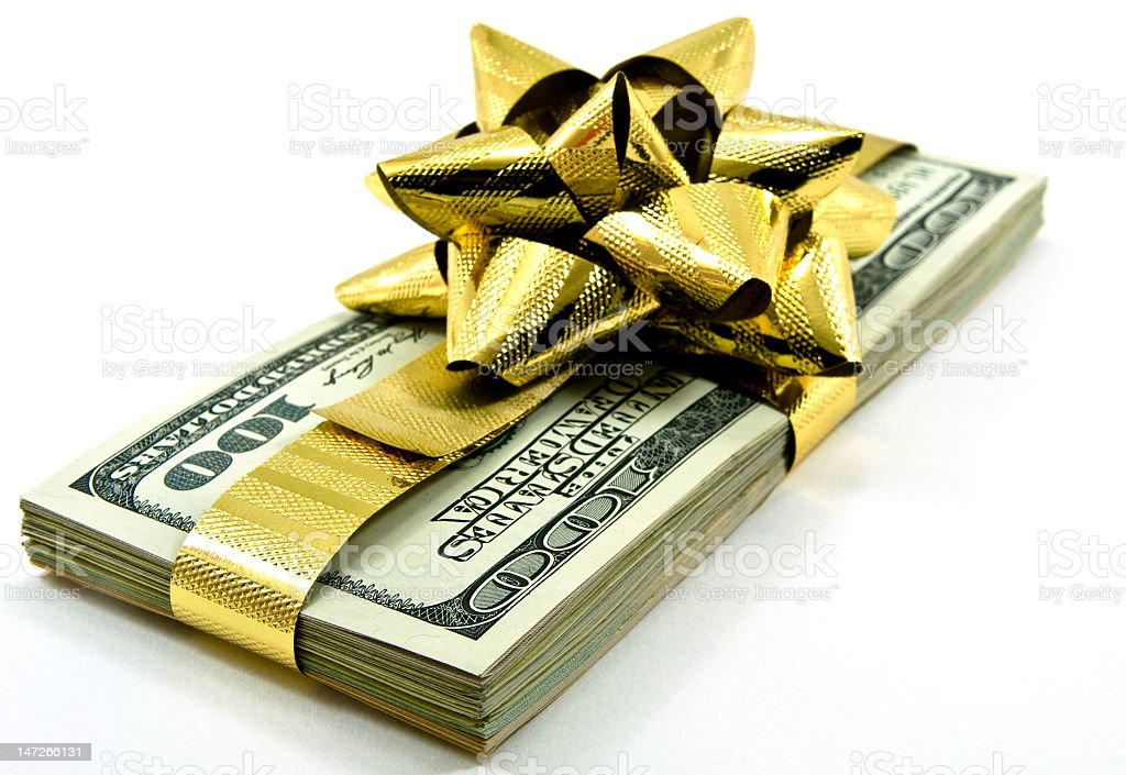 Stack of dollar notes tied together with a gold bow royalty-free stock photo