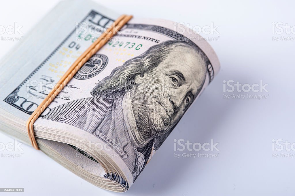 Stack of dollars with rubberband stock photo
