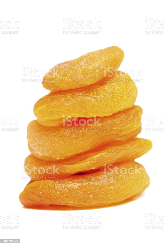 Stack of dried apricots on white stock photo