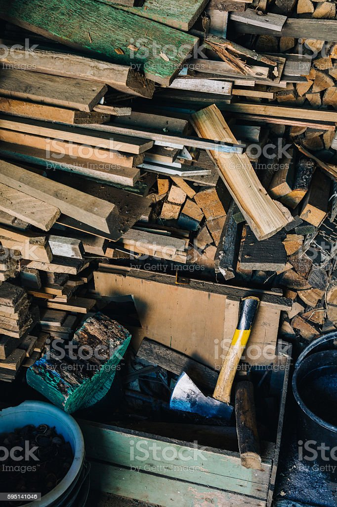 Stack of dry firewoods indoor stock photo