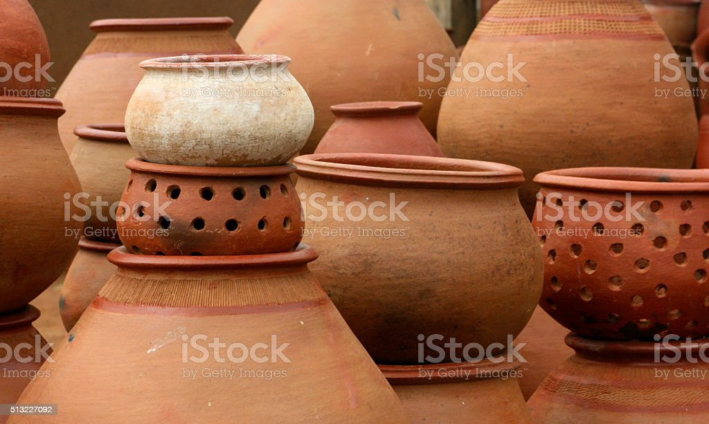 Stack of earthenware pots stock photo