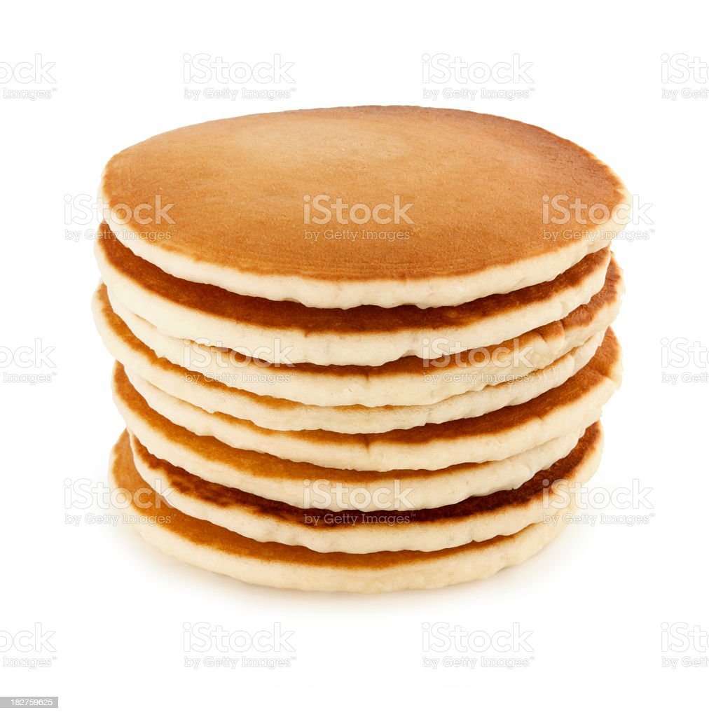 Stack of eight buttermilk pancakes on a white table stock photo