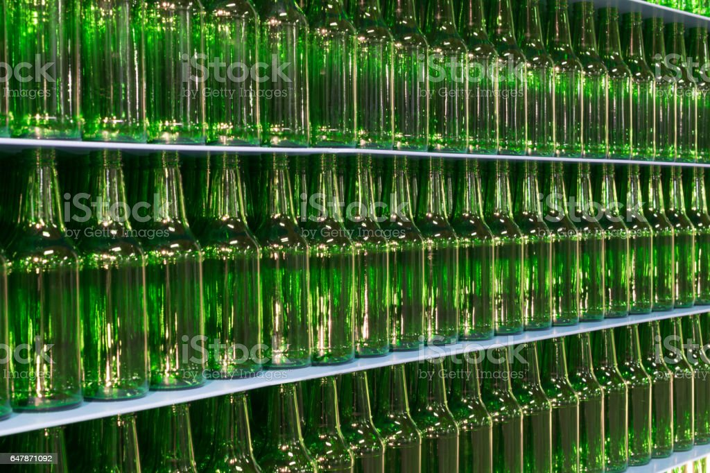stack of Empty green beer glass Bottles stock photo