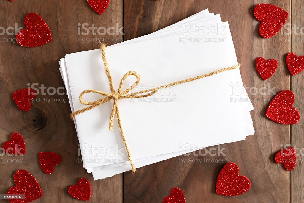 Stack of Envelopes tied with Twine Bow Surrounded stock photo