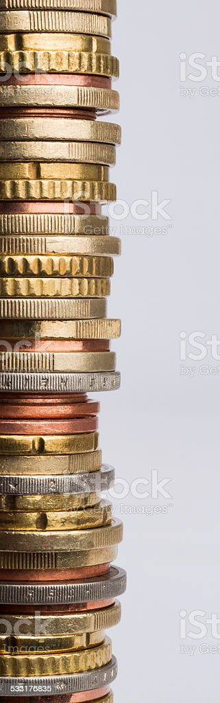 stack of euro coins in grey background stock photo