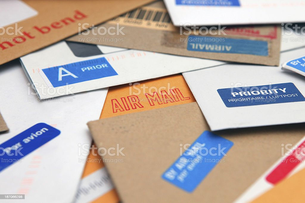 Stack of express air mail envelopes with stickers and stamps stock photo