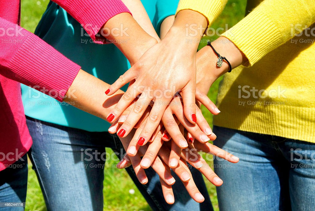 Stack of female hands stock photo