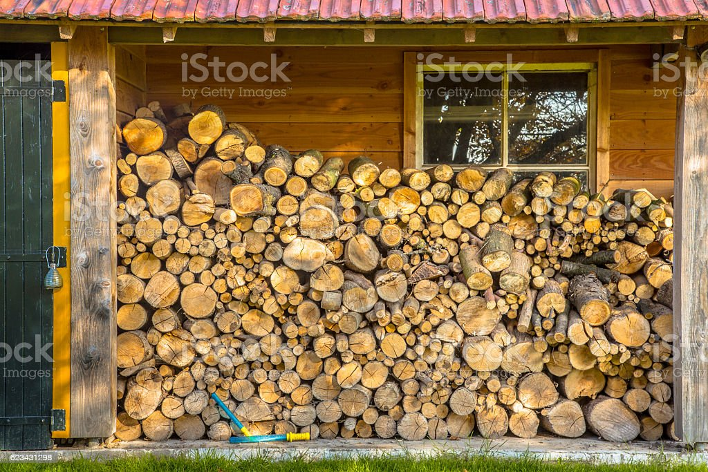 Stack of firewood in a barn stock photo