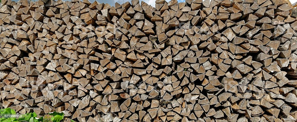 stack of firewood outdoor stock photo