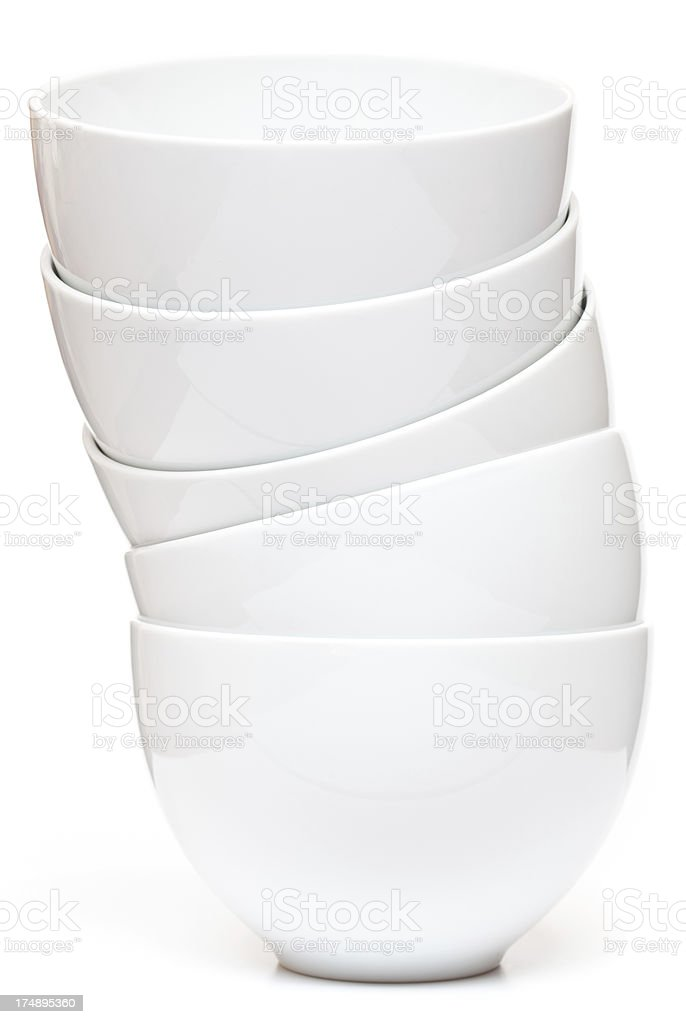 Stack of five white ceramic bowls royalty-free stock photo