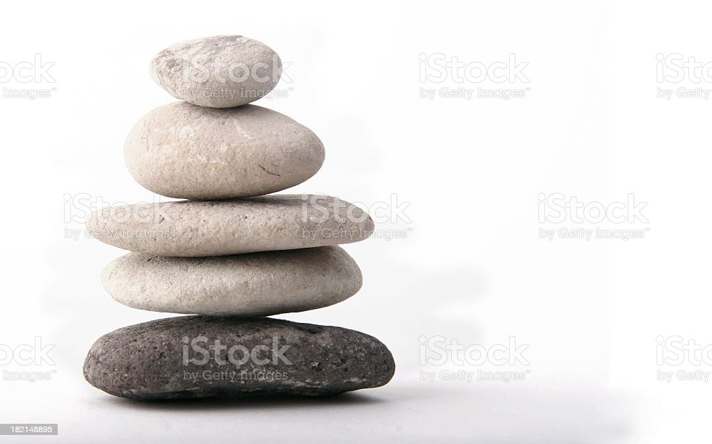 A stack of flat rocks on a white background stock photo