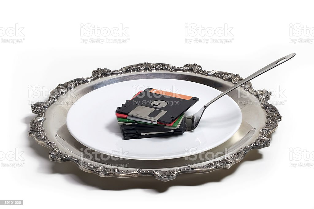 Stack of floppy disks serverd on white plate stock photo