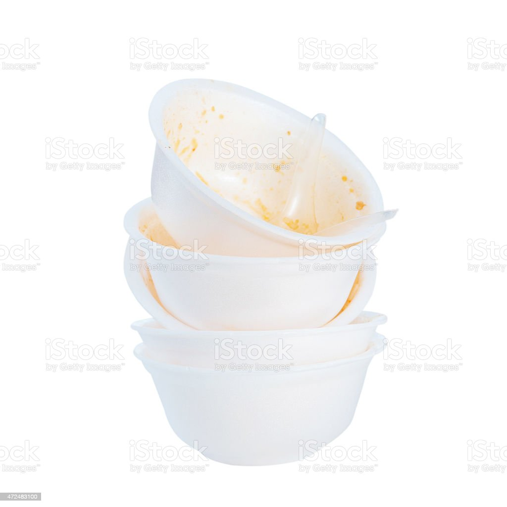 Stack of foam bowl and plastic spoon after eating stock photo