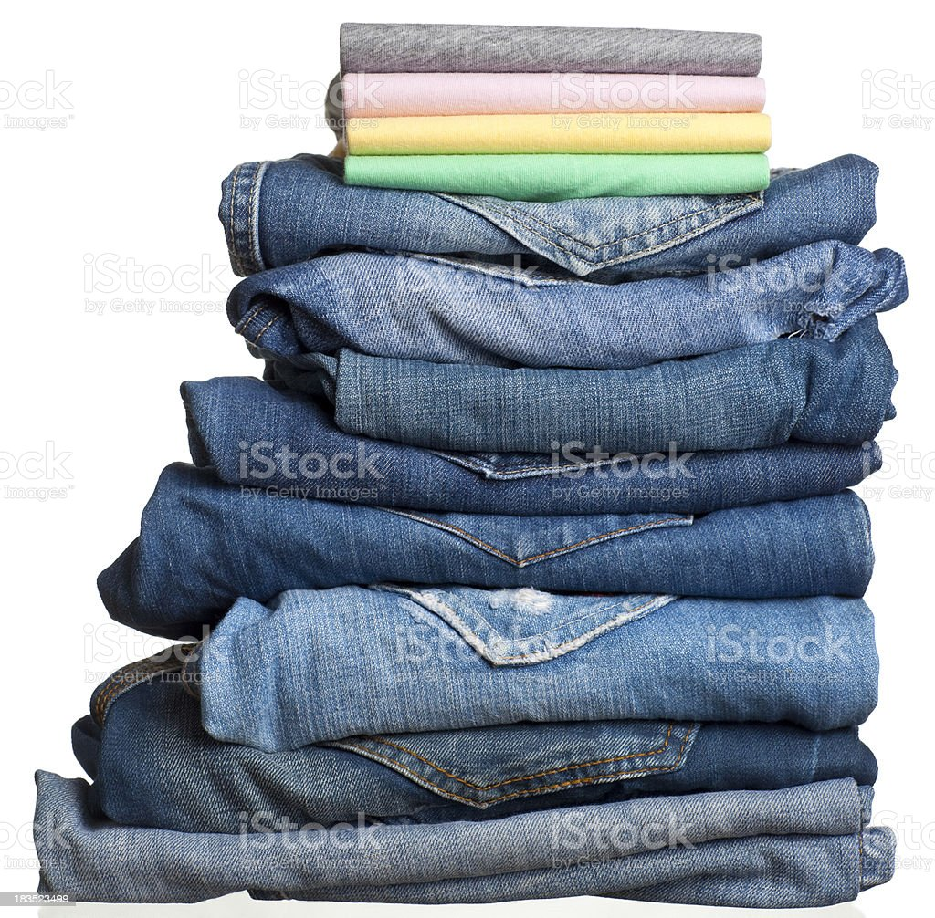 Stack of folded jeans and T-shirts. royalty-free stock photo