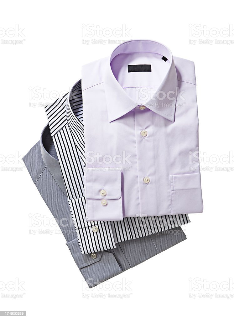 A stack of folded men's shirt of different colors stock photo