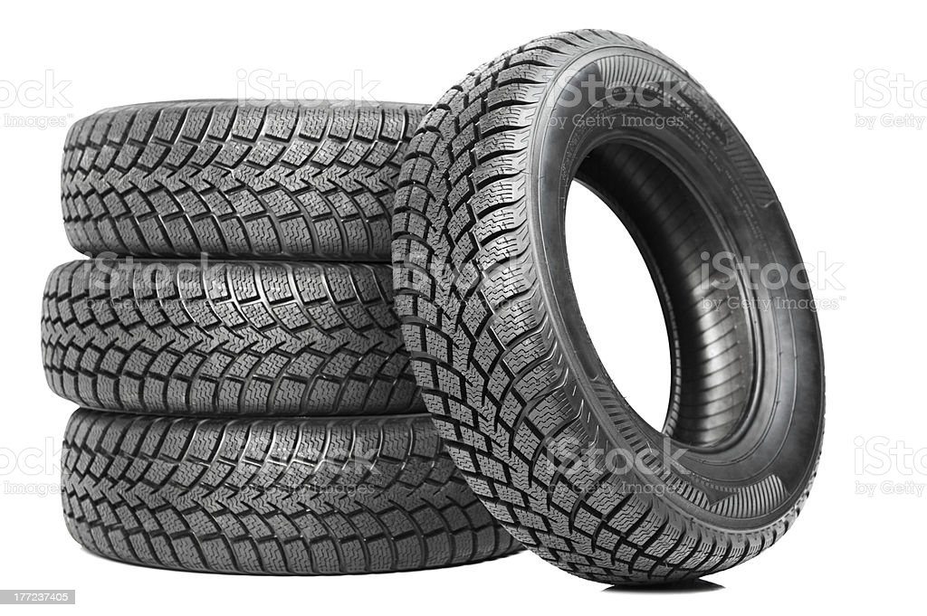 Stack of four black car tires isolated on white stock photo