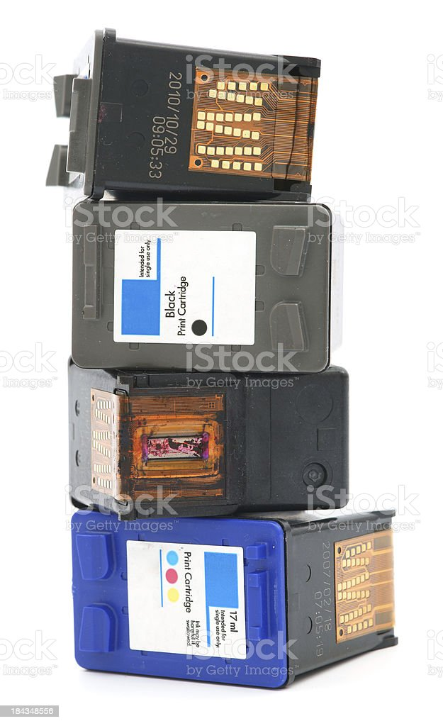 Stack of four ink cartridges on white background royalty-free stock photo