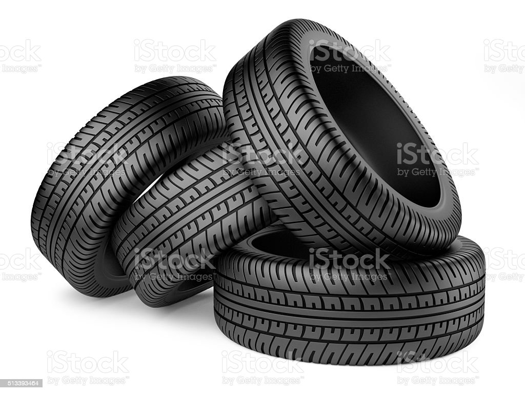 Stack of four new black wheel tyres for car stock photo