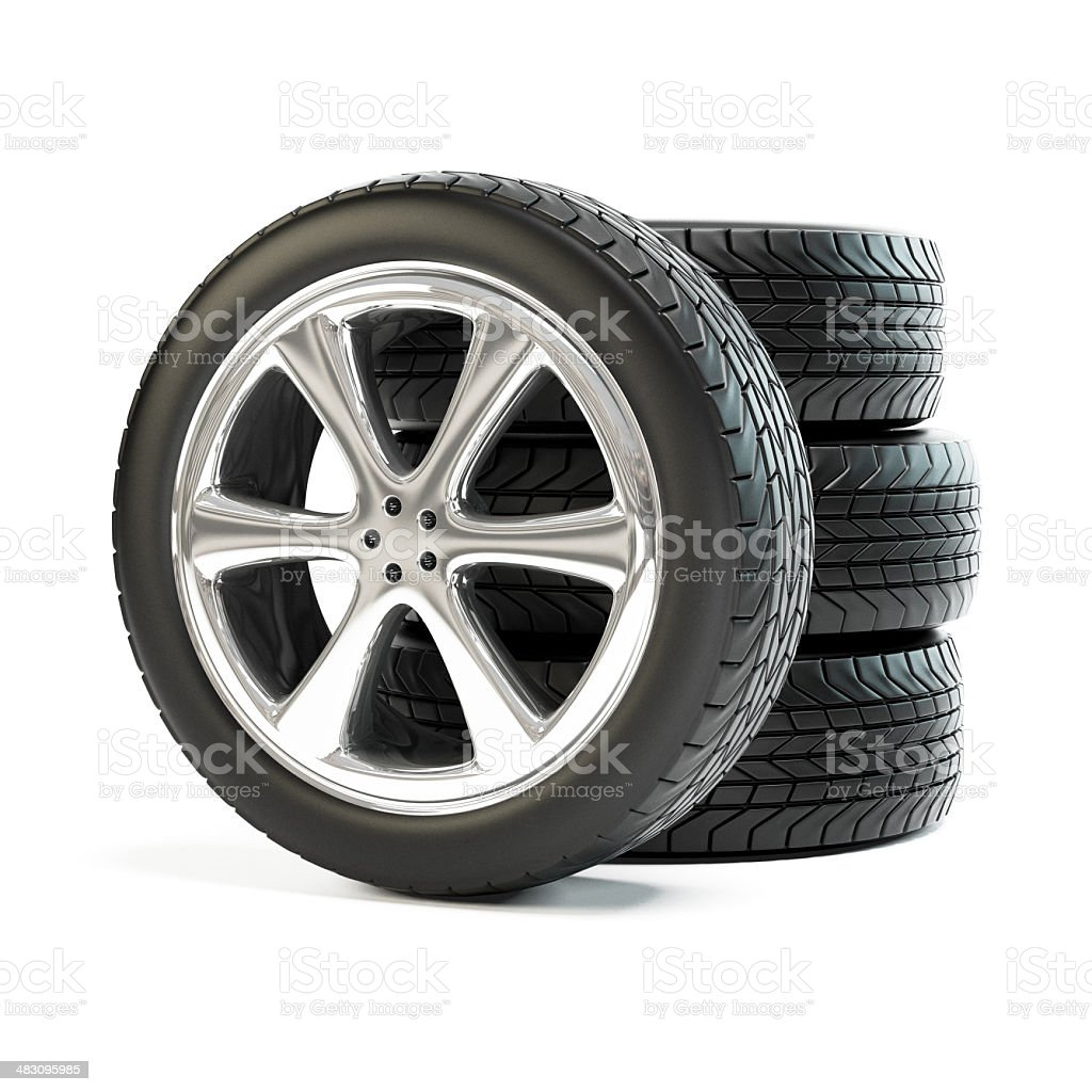Stack of four new car wheels. Black tyres isolated stock photo