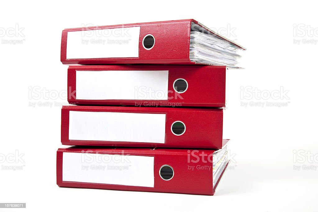 Stack of four red ring binders with spine facing viewer stock photo