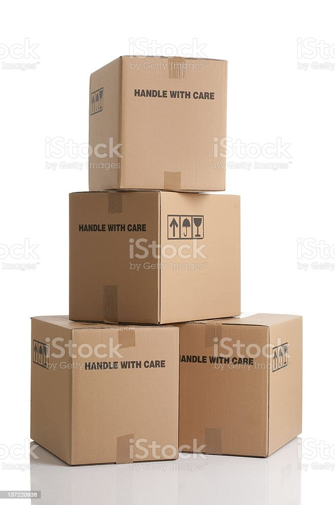 Stack of fragile brown shipping boxes stock photo