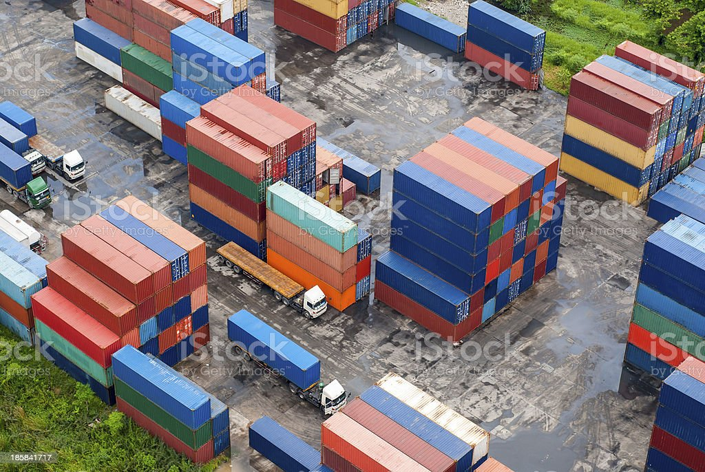 Stack of Freight Containers at the Docks with Truck royalty-free stock photo