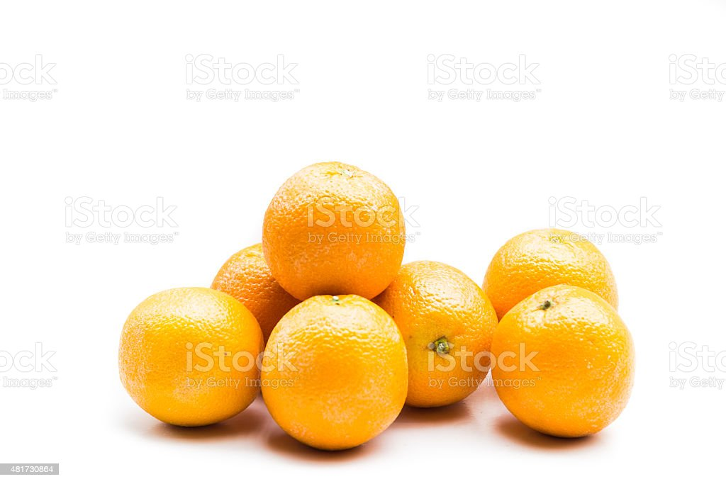 Stack of fresh and juicy naval oranges isolated in white stock photo