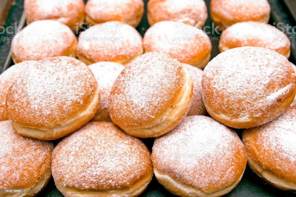 Stack of fresh Berliner jelly doughnuts stock photo