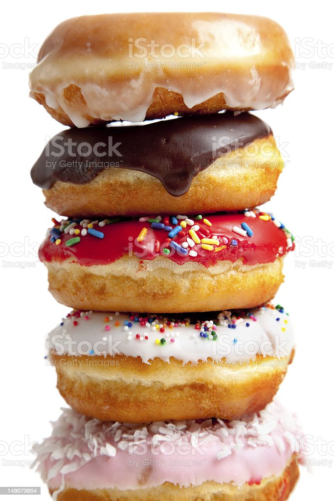 Stack of fresh, colorful donuts stock photo