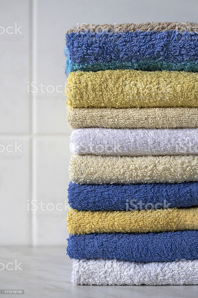 Stack of fresh washed colorful fregnant towels royalty-free stock photo