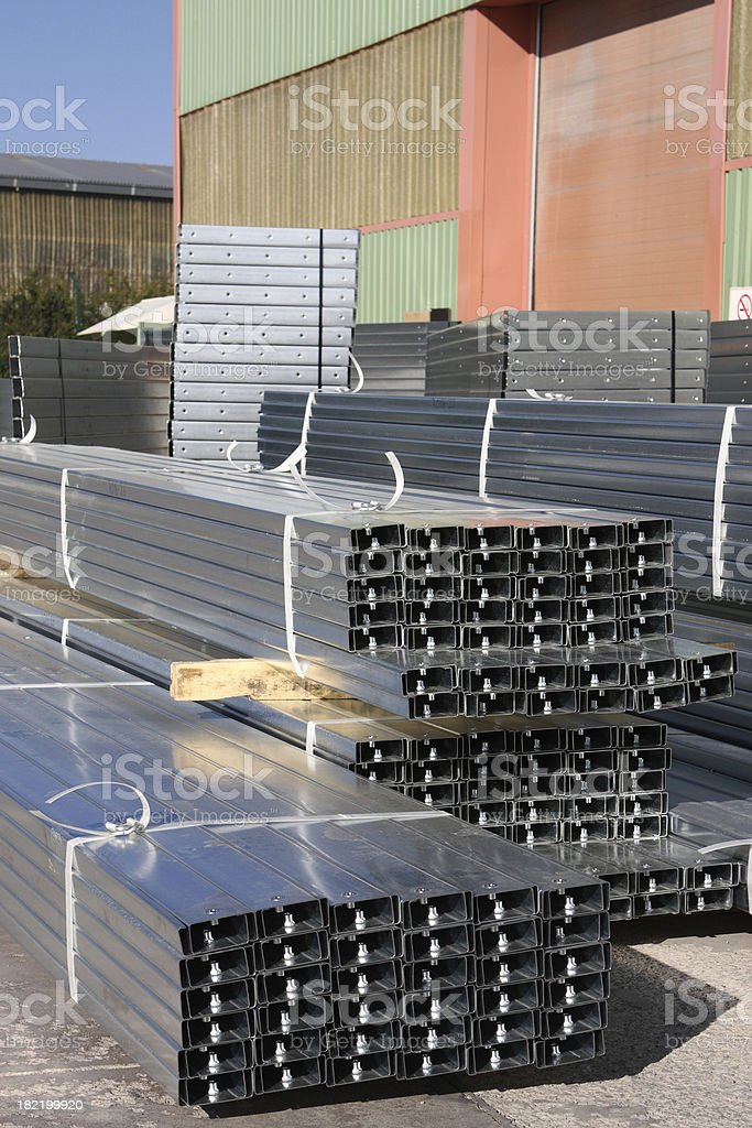 stack of galvanised steel poles royalty-free stock photo