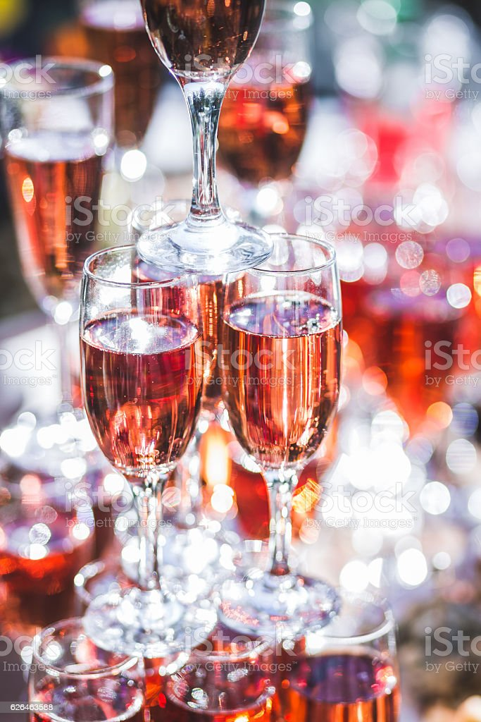 Stack of glasses champagne at reception in the open air stock photo