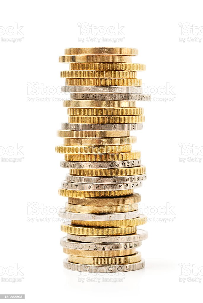 Stack of gold and silver coins piled together royalty-free stock photo