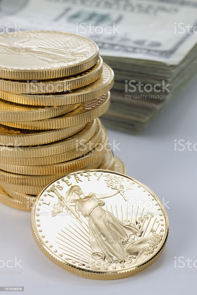 Stack of Gold Coins & Hundred Dollar Bills. royalty-free stock photo