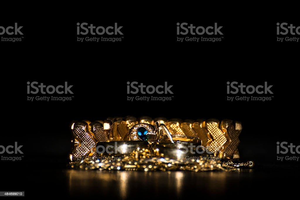 Stack of gold jewerly stock photo