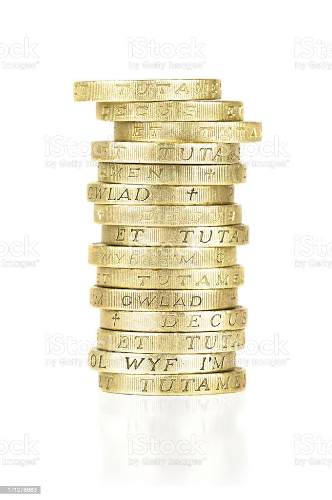 Stack of gold, one pound coins stock photo