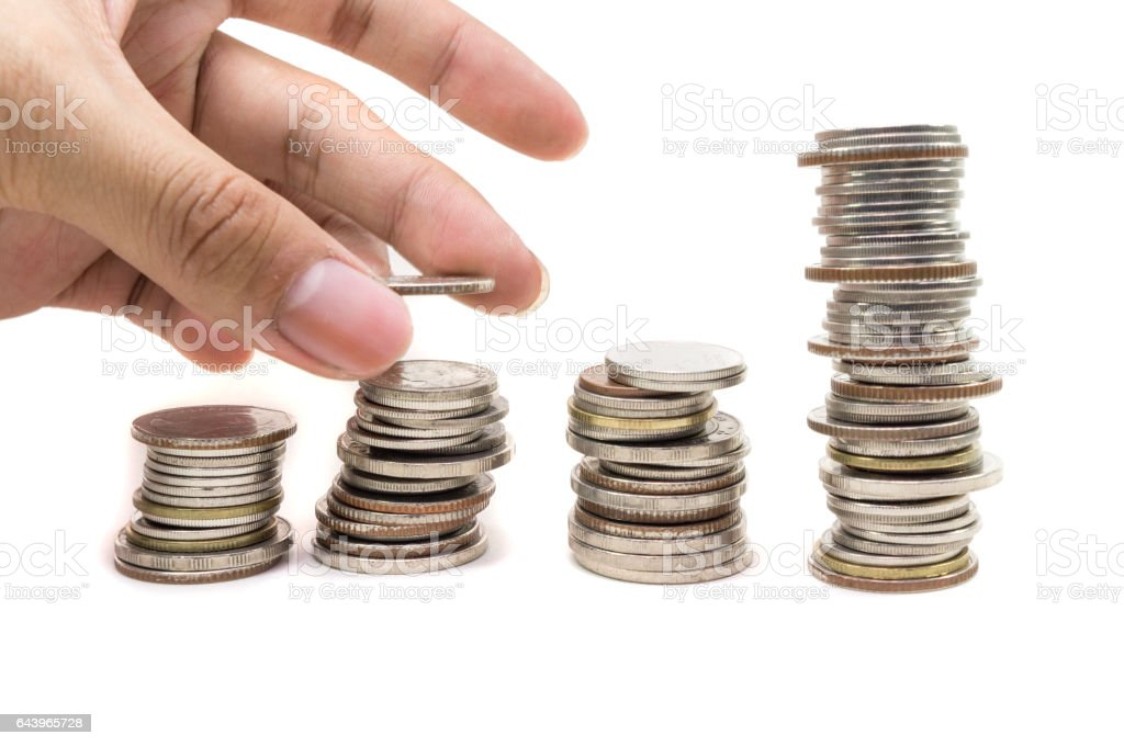 stack of golden coins and human hand stock photo