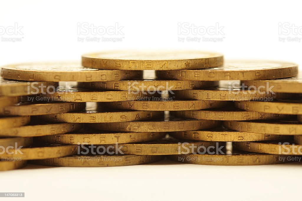 Stack of golden coins isolated on white royalty-free stock photo