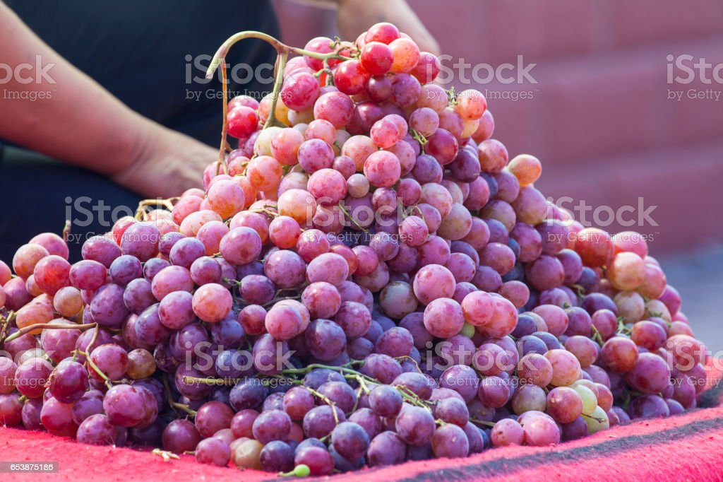 Stack of Grape in local market stall in Zhangye, China. stock photo