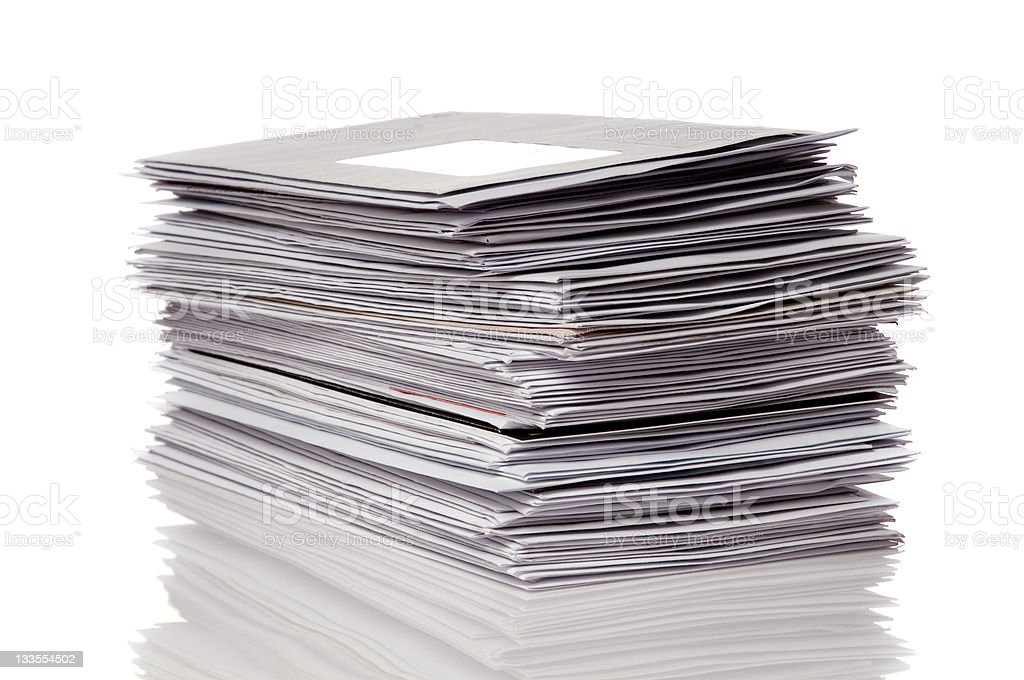 Stack of gray unopened mail reflected on white background stock photo