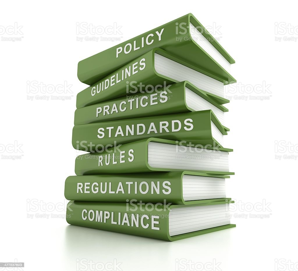 Stack of green compliance and rules books stock photo