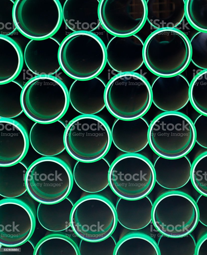 Stack of Green PVC Pipes stock photo