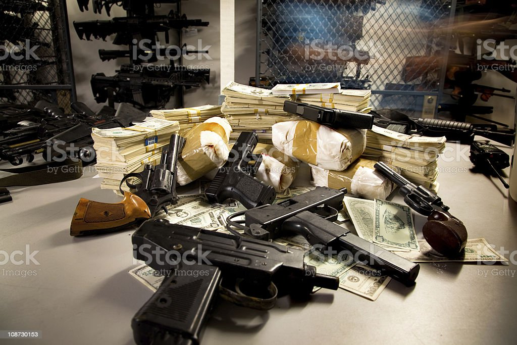 Stack of Guns, Drugs, and Cash royalty-free stock photo