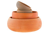Stack of handmade round unglazed clay pots in different size