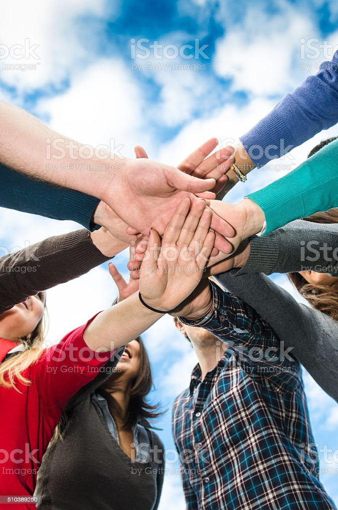 Stack of hands of volunteer stock photo