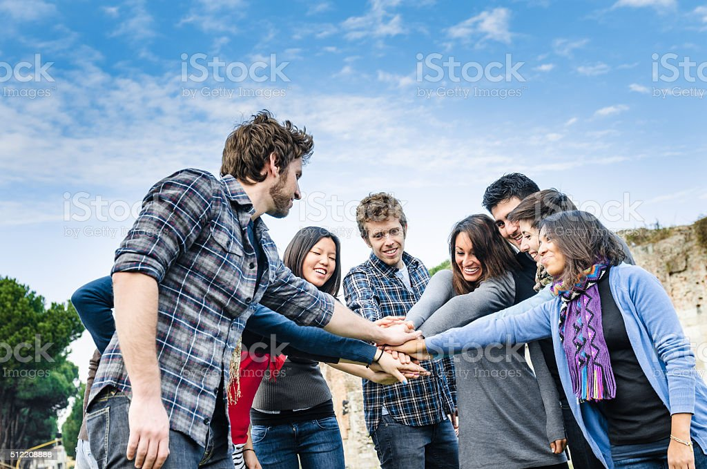 Stack of hands of volunteer stock photo